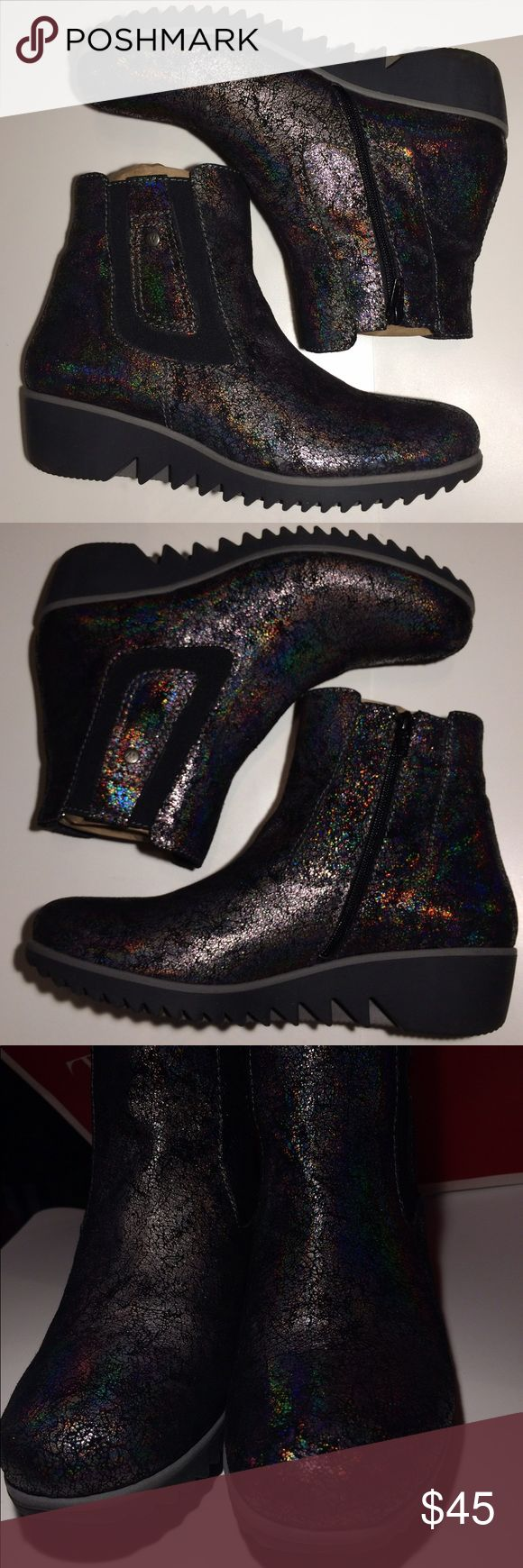 Black Silver Prism Heeled Walking Boots 🆓B2G1🆓 Silver Black Prism Heeled Walking Boots. Made in Portugal.             EUC - only worn once by my sister and then passed on to me. They are not my style. Wolky Shoes Heeled Boots