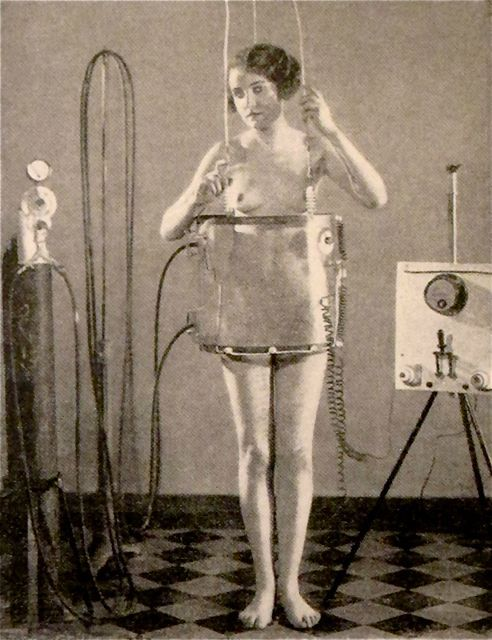 Dr Flaxlander's hip slimming machine - what's most interesting is why she needs to be naked?