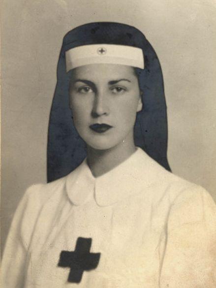 A strikingly beautiful nurse; date unknown.  (I just love her dark lipstick!)