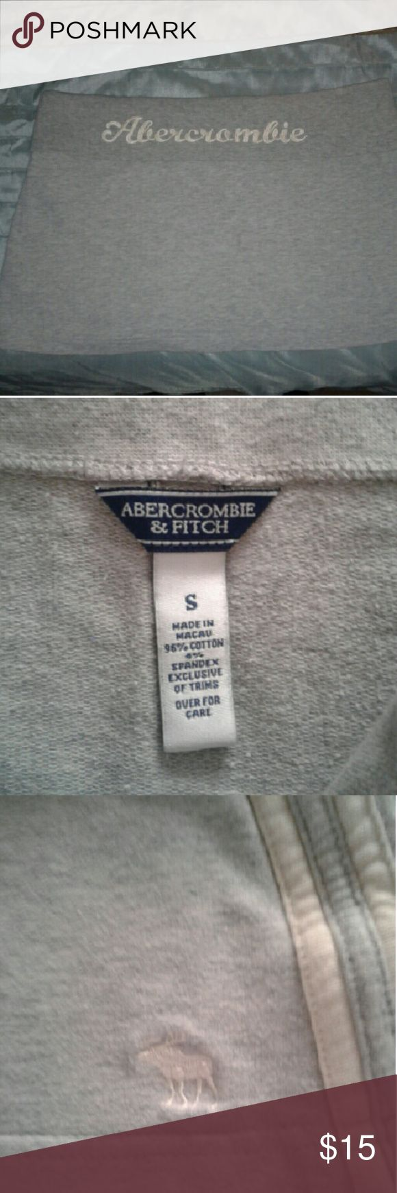 Abercrombie and Fitch Mini Skirt Gray Small Gray Abercrombie and Fitch Mini Skirt Size Small Cotton & Spandex Fold Down Top With Abercrombie on back of Skirt has set of Lines Down Both sides of Skirt. Pre-loved but Good Condition. Abercrombie & Fitch Skirts Mini
