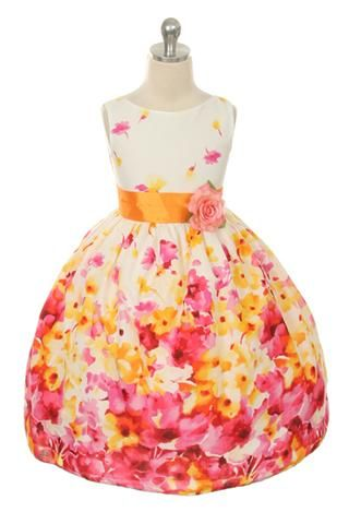 Beautiful flower printed dress, accented with a color sash. Colors: Fuchsia, Lavender Sizes: 2-12 MADE IN USA