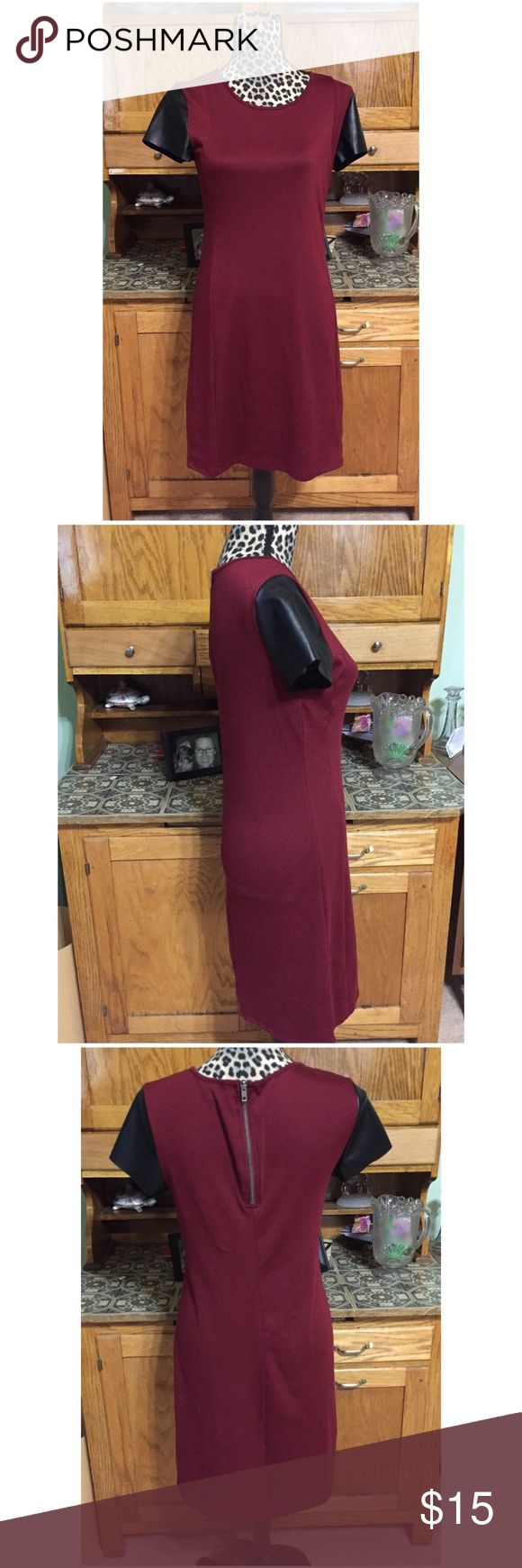 """Edgy Dress with faux leather sleeve detail Nice seasonal transition dress. Waist is about 15"""", bust is about 16"""" and length is about 36"""". All measurements taken lying flat. I am a suggested user and have a five star closet. Check my reviews and buy with confidence!  😍 Dresses"""