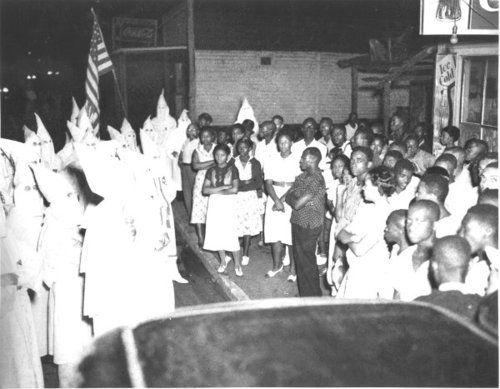 """Previous pinner: """"This picture gave me chills. Look which side is so filled with cowardice that every single one of their faces are covered. Because I couldn't resist doing some snooping, apparently this picture is from a 1938 stand-off between the Klan and Black residents/locals of Lakeland, Florida. I found it in a special exhibition archive at the Lakeland city website, here. And here's an article recounting historical and current racial tensions in Polk County and Lakeland in specific."""""""
