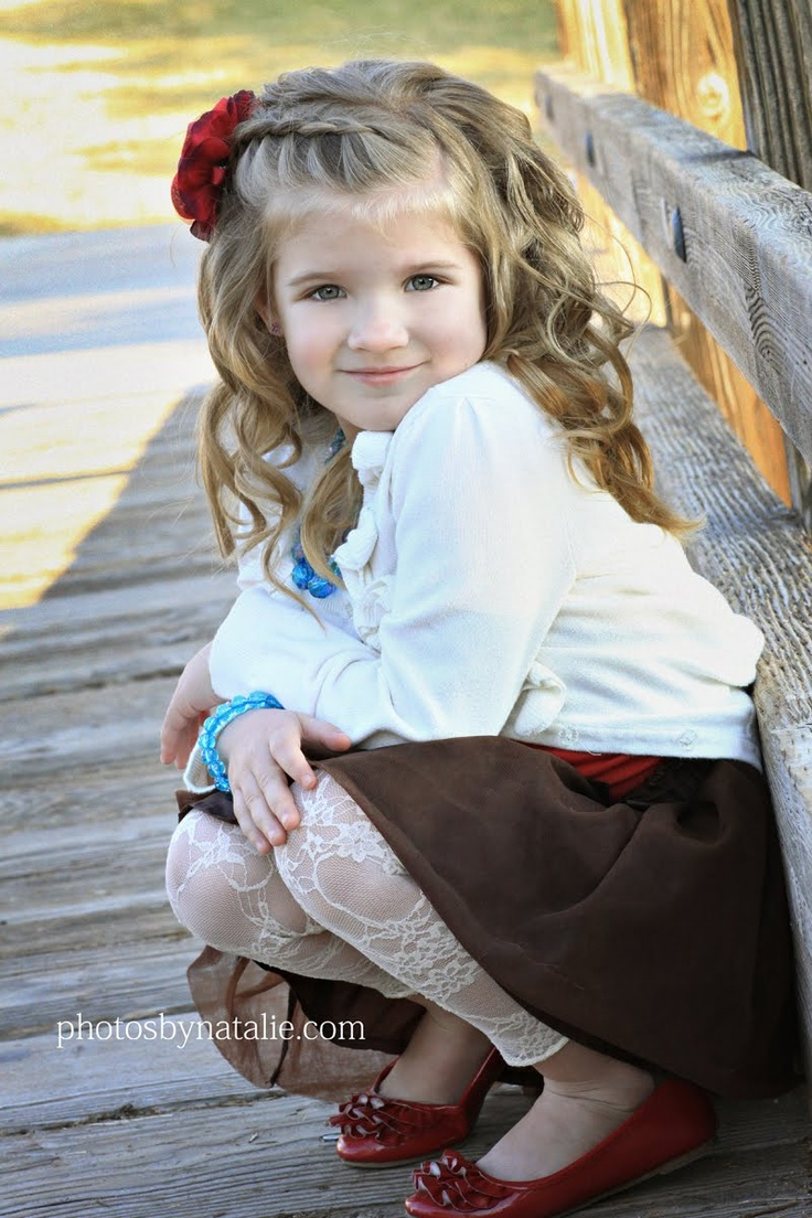 This child is beautiful.  Love the hair