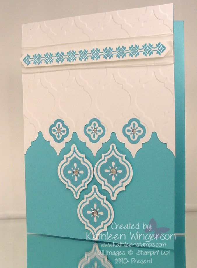 "Stampin' Up! Mosaic Madness; Whisper White and Tempting Turquoise card stock; Tempting Turquoise ink; Big Shot Modern Mosaic embossing folder; Mosaic punch; Stamp-a-ma-jig; Whisper White 5/8"" Organza ribbon, Rhinestones."