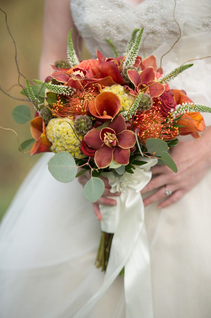 Warm fall wedding bouquet of yellow cockscomb, orange calla lilies, orchids, berries and dark red roses ~ we ❤ this! moncheribridals.com