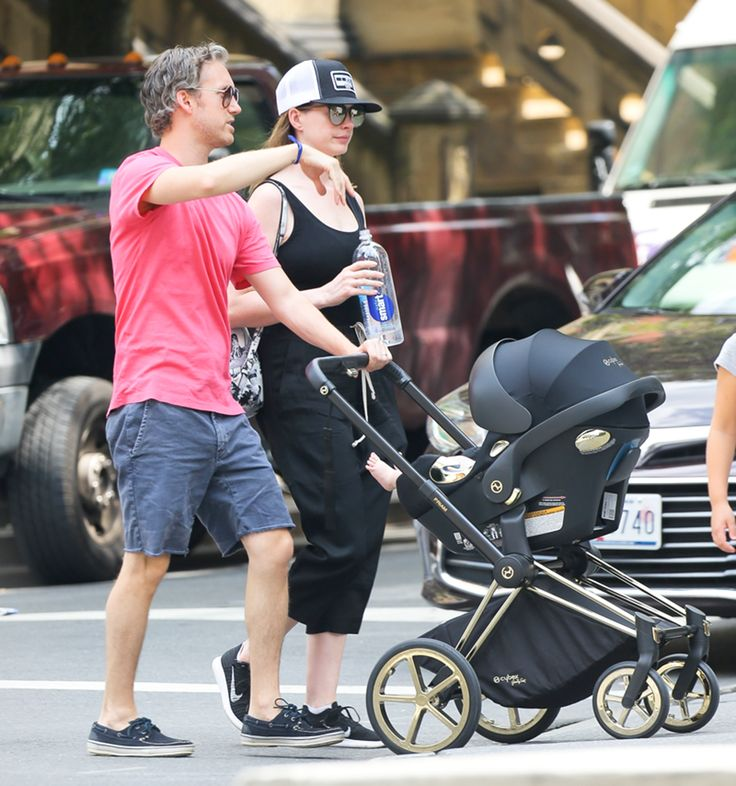Actress Anne Hathaway seen with iconic PRIAM from the CYBEX by Jeremy Scott Wings Collection.  Oscar-winning actress Anne Hathaway cut a stylish figure as she was spotted in New York pushing her son in a Priam travel system with Aton Q from the CYBEX by Jeremy Scott Wings Collection.