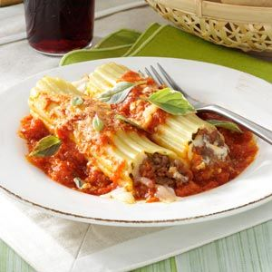 Meaty Manicotti Recipe -This simple dish has been very popular at family gatherings and potlucks. You can assemble it ahead of time. —Lori Thompson, New London, Texas