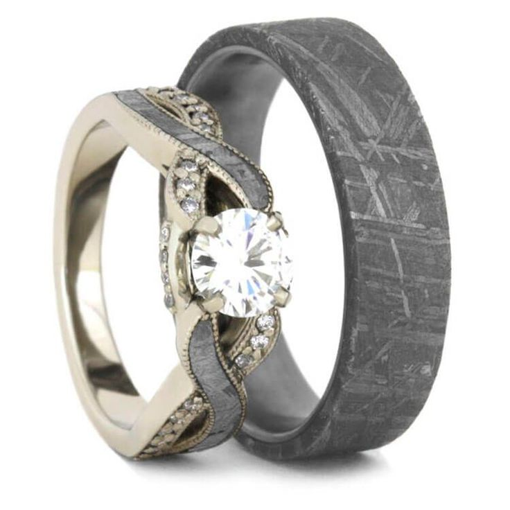A wonderful meteorite wedding ring set perfect for the couple who is looking to be unique. The women's round cut moissanite engagement ring is designed with