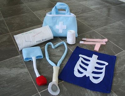 The Doctor Is In Felt Play Set  Band-aids, an x-ray, roll bandage, stethoscope, cast, blood pressure cuff & medical bag to put it in.