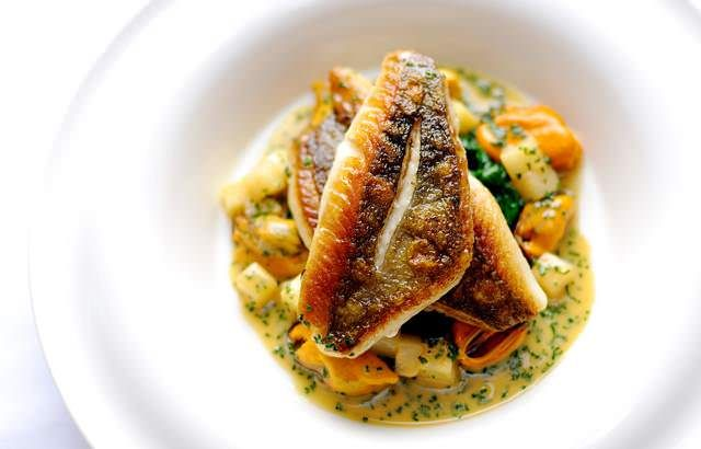 Fish fillets are served with mussels, apples and celeriac in William Drabble's John Dory recipe. John Dory is delicious, and this recipe is simple to prepare.