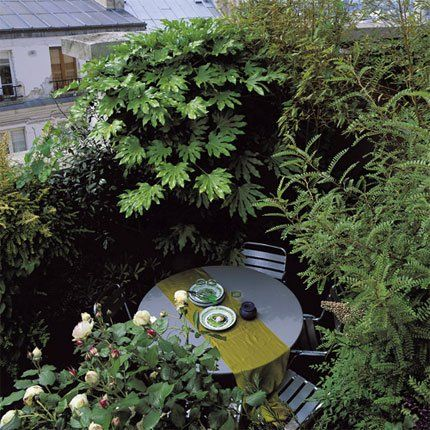 a balcony like a real small urban garden in Paris, France