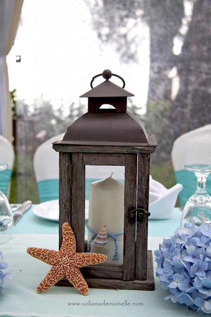 White washed lanterns with shells for beachie theme decor