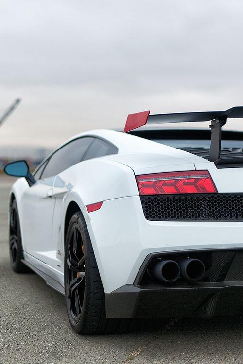 Lamborghini. White with black interior, rims and red details