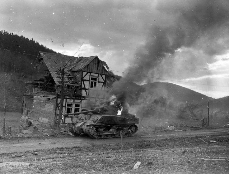 https://flic.kr/p/rW6aKn | Sherman from the 7th Armored Division of the US Army, knocked out in the village Oberkirchen, Germany.
