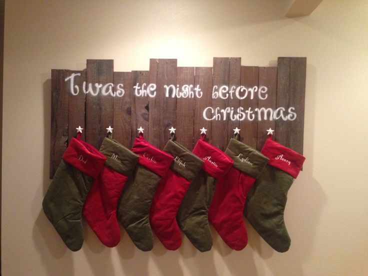 Rustic stocking hanger made out of an old pallet with star knobs.