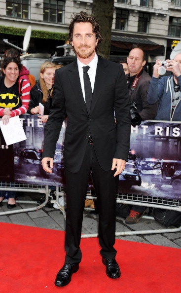 Christian Bale wore a Gucci black notch lapel two button Signoria suit with white dress shirt, black silk tie and black leather belt neckline to the European Premiere of 'The Dark Knight Rises' on July 18, 2012 in London, England.: The Dark Knights, Black Ties, Christain Bale, Christian Bale, Favourit Celebrity, Bale 2012, Groomsmen Suits, Bale Suits, Hot Guys