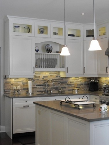 Lighting underneath cabinets and I love the lights over the island