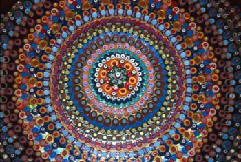 Tom Deininger uses statistics to determine the pattern of his upcycled bottle cap art. Way cool! Love the way it looks!