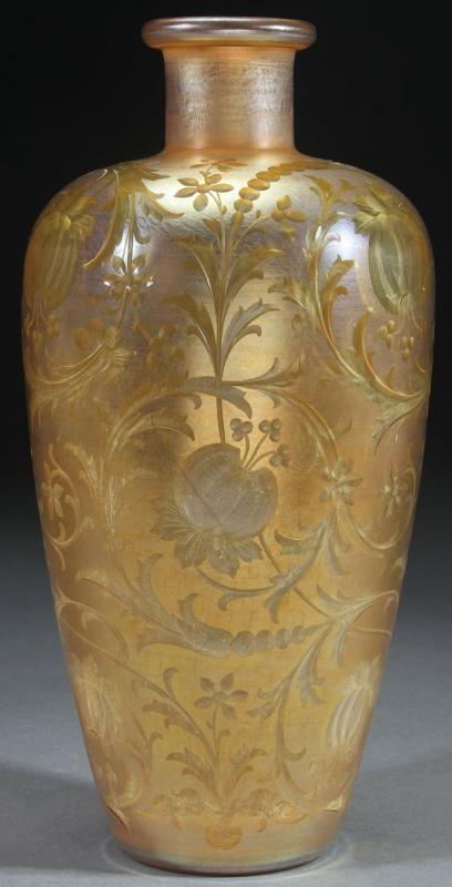 L.C. TIFFANY FAVRILE INTAGLIO CUT GLASS VASE, CIRCA 1916.                                                                                                                                                                                 More