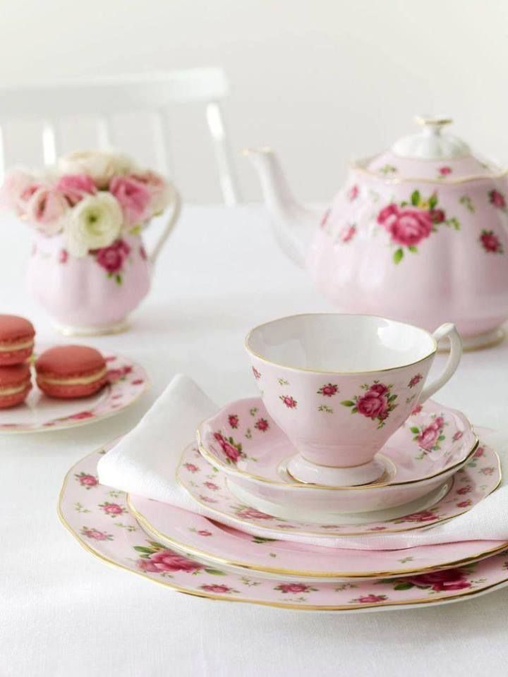 The roses are a nice touch to this lovely tea set!