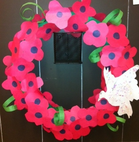 Remembrance Day Wreath-Kids traced poppies, used a bingo dauber for the centre and glued it to a green crepe covered twisted paper wreath. We added a little snow glitter to the white dove : )