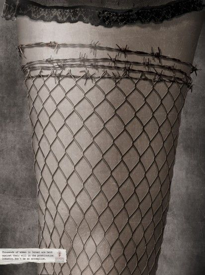 Design: An ad against illegal sex trafficking of women. Stocking resembles a fence and the top, barbed wire...