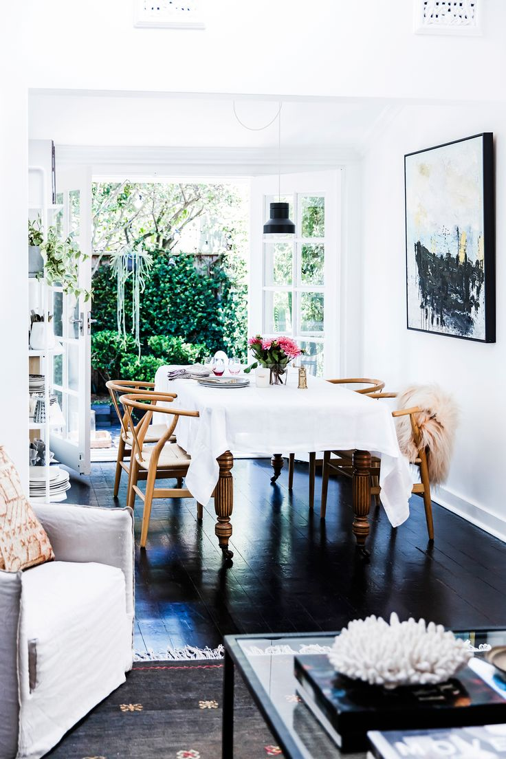 French doors are the hero of this stunning dining room in a Bondi home, creating a seamless indoor/outdoor entertaining space. Photography: Maree Homer | Styling: Kristen Bookallil | Story: real living