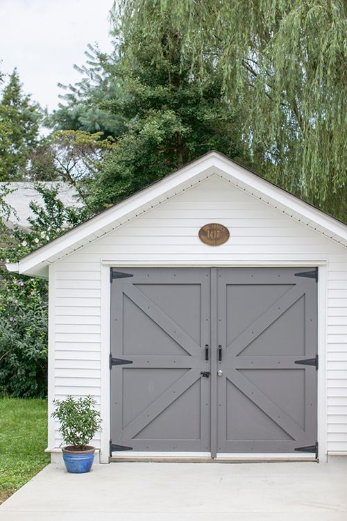 Gray garage doors in benjamin moore kendall charcoal paint for Exterior shed doors design