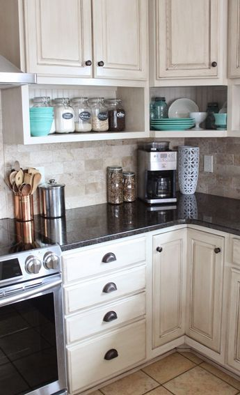 Raised wall cabinets with shelves built underneath. Namely Original: Painted kitchen and remodel reveal CabinetsAndDesigns.net
