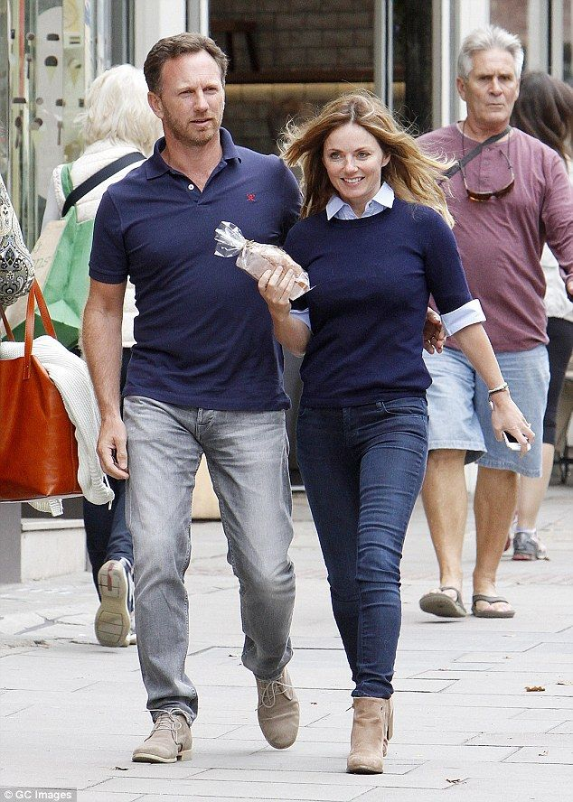 Happy couple: Geri Halliwell, 43, trod the London streets on Wednesday with her handsome husband, 41-year-old Formula One boss Christian Horner