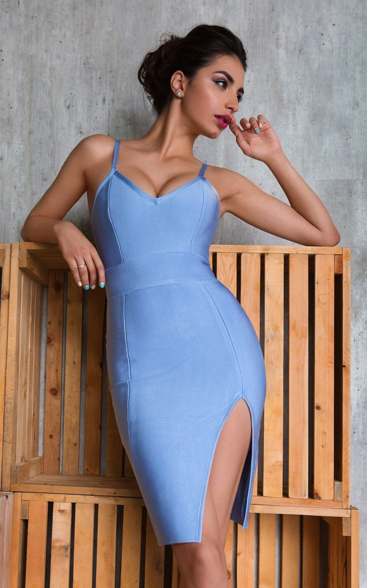 A pretty little blue bandage dress with spaghetti straps and a front thigh slit.