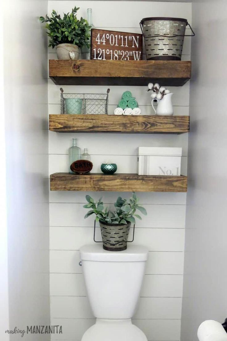 Farmhouse bathroom with wood floating shelves above toilet with shiplap accent w…   – bathroom shelves
