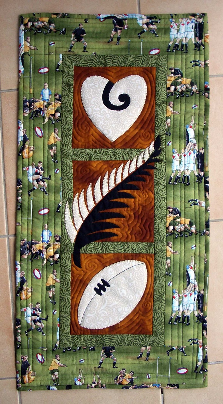 NZ Rugby quilted - Designed by Mary Metcalf There are three icons - the heart with the koru shows the passion for the game - the silver fern, our special NZ symbol worn with pride - the rugby ball which defines the game.