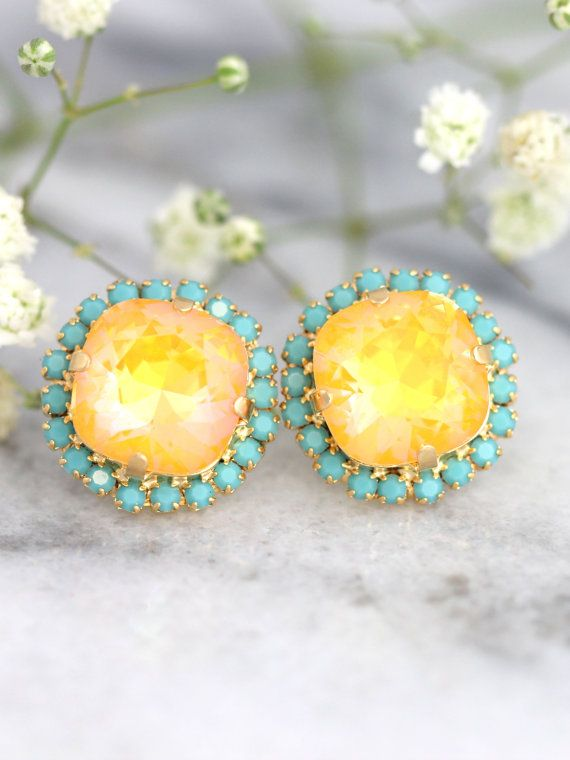 Canary Yellow earrings Canary Yellow Diamond earrings Lemon Swarovski earrings Yellow Stud earrings Turquoise Yellow wedding earrings . Elegant earrings with Ultra Yellow and Turquoise Swarovski © Crystals . This is a special shimmery color effect, SWAROVSKI ELEMENTS with custom coatings (Coatings are not applied by Swarovski) Petite Delights is an Official SWAROVSKI® Branding Partner Official Swarovski Elements® Partner Made with real genuine high quality Austrian Swarovski ©Crystal . Our…