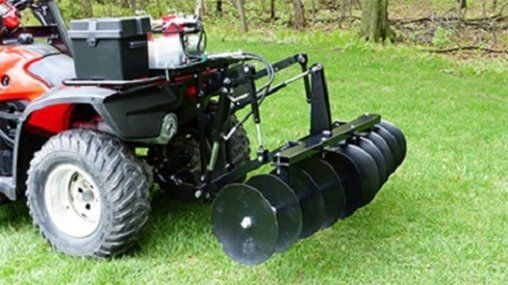 ATV quad bike with discs attachment on rear. Once these ATV Hydraulic Quad Bike Discs are attached to your ATV Quad you are ready for getting the soil ready for planting by aerating the soil, braking up clumps and levelling the terrain. For info: http://www.fresh-group.com/atv-hydraulic-discs.html