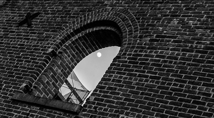I caught the moon through the window of this old building while walking around the waterfront of Brooklyn..