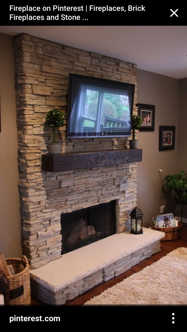 Inset TV above fireplace  fireplace ideas  Stacked stone fireplaces Living room with