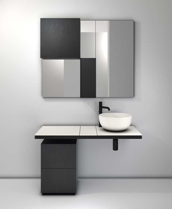 Multiplo modular bathroom collection by CIELO, made up of ceramic washbasin and lacquered wood top in the Talcum finish. The base structure is in matte black lacquer and the drawers are black oak. The wall units have the same finish, alternating and combining with the mirror. The color combination boosts the line's dynamic style and young, carefree spirit. #bathroomdesign #ceramic #interiordesign #HandMadeinItaly #Inspiration #washbasin
