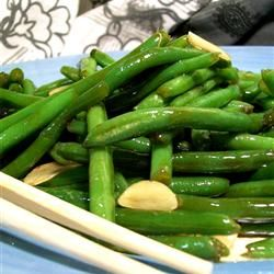 Chinese Buffet' Green Beans  Every time my family and I go to a Chinese buffet we make a bee line for the green beans! This is a simple and tasty re-creation of that much loved side dish, goes well with any Asian meal. Make sure to slice the garlic, don't use a garlic press. Oyster sauce can be found in the Asian section of your grocery store, at an Asian grocery store, and online.