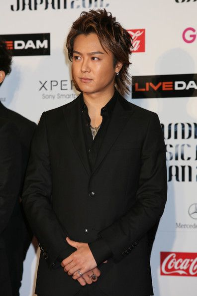 Takahiro Exile | Takahiro EXILE poses for photographs on the red carpet of the MTV ...