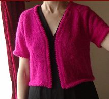 Knitting pattern for a ladies short sleeve jacket with picot edges.