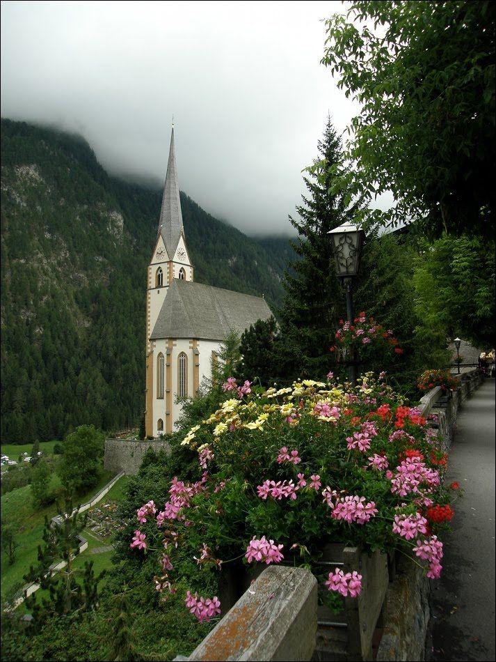 Heiligenblut in Austria. The Gothic pilgrimage church of Saint Vinzenz, with its needle spire, was built between 1460-1491.