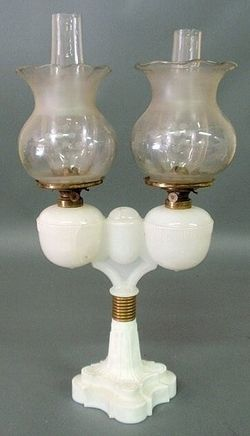 lighting, America, An E. Miller & Co. wedding lamp marked Pat. Jul 21, 1863, milk glass base and match holder with cover, one globe larger.