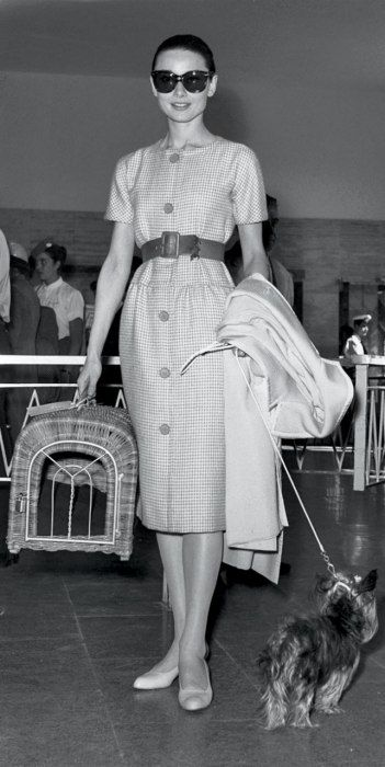 Audrey Hepburn | wearing sunglasses: Oliver Goldsmith. dress: Pierre Cardin. belt: Givenchy. shoes: Chanel | 1958