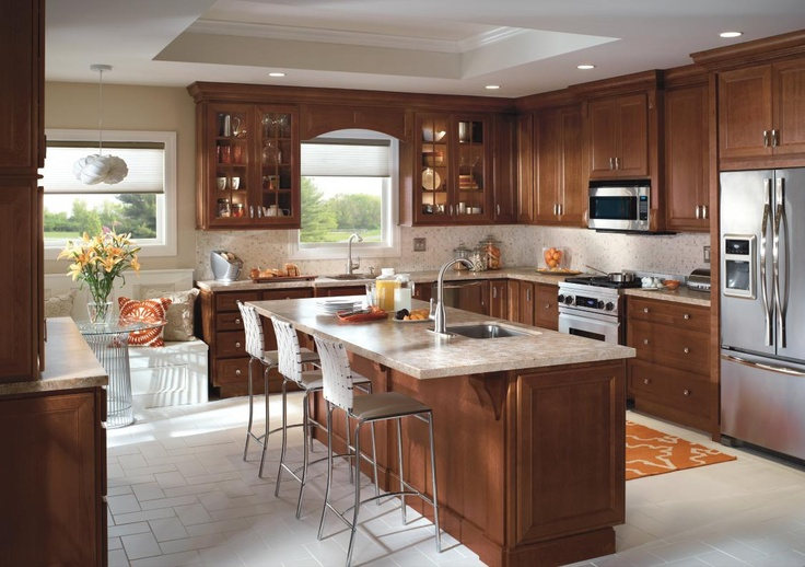 Kitchen cabinet design from homecrest cabinetry includes Eat in kitchen island