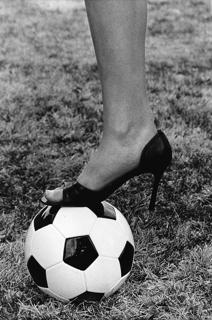 """This is one of my dad's favorite portraits of me.    i showed it to my soccer coach and his first reaction was """"how did you find a soccer ball that was so shiny?"""" i had to explain that that's what they look like if you never play with them, he then moc Yeah!"""
