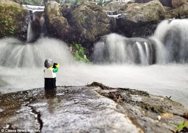 Little tourist: Andrew Whyte has been photographing a Lego man at a variety of locations in Portsmouth, Hampshire, since August 2012