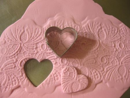 fondant lace hearts. Imagine doing this with cookie dough.