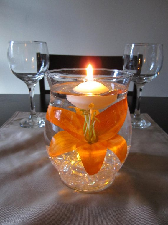 Hurricane vase floating candle centerpiece with artificial